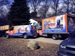 Water Damage Restoration Fleet At Job Site