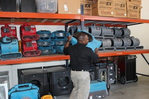 Water Damage Edwards Technician Mobilizing Air Movers