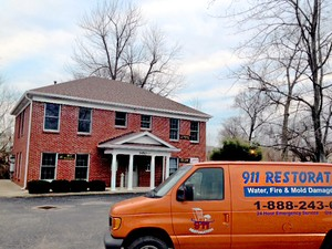 Water Damage Restoration Van At Fall Residential Job Location