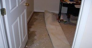 Water Damage In Bedroom After Flooding Incident