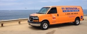 Water and Mold Damage Restoration Van Driving To Job Site