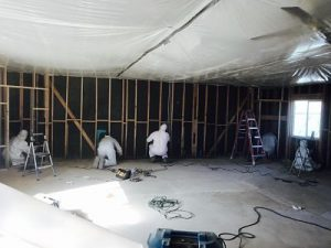 Technicians Conducting Flood Repairs In A Commercial Property