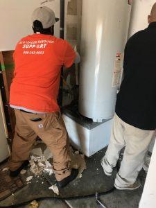Repair Techs Fixing A Water Heater Burst